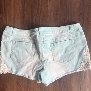 Teal denim shorts with lace detail